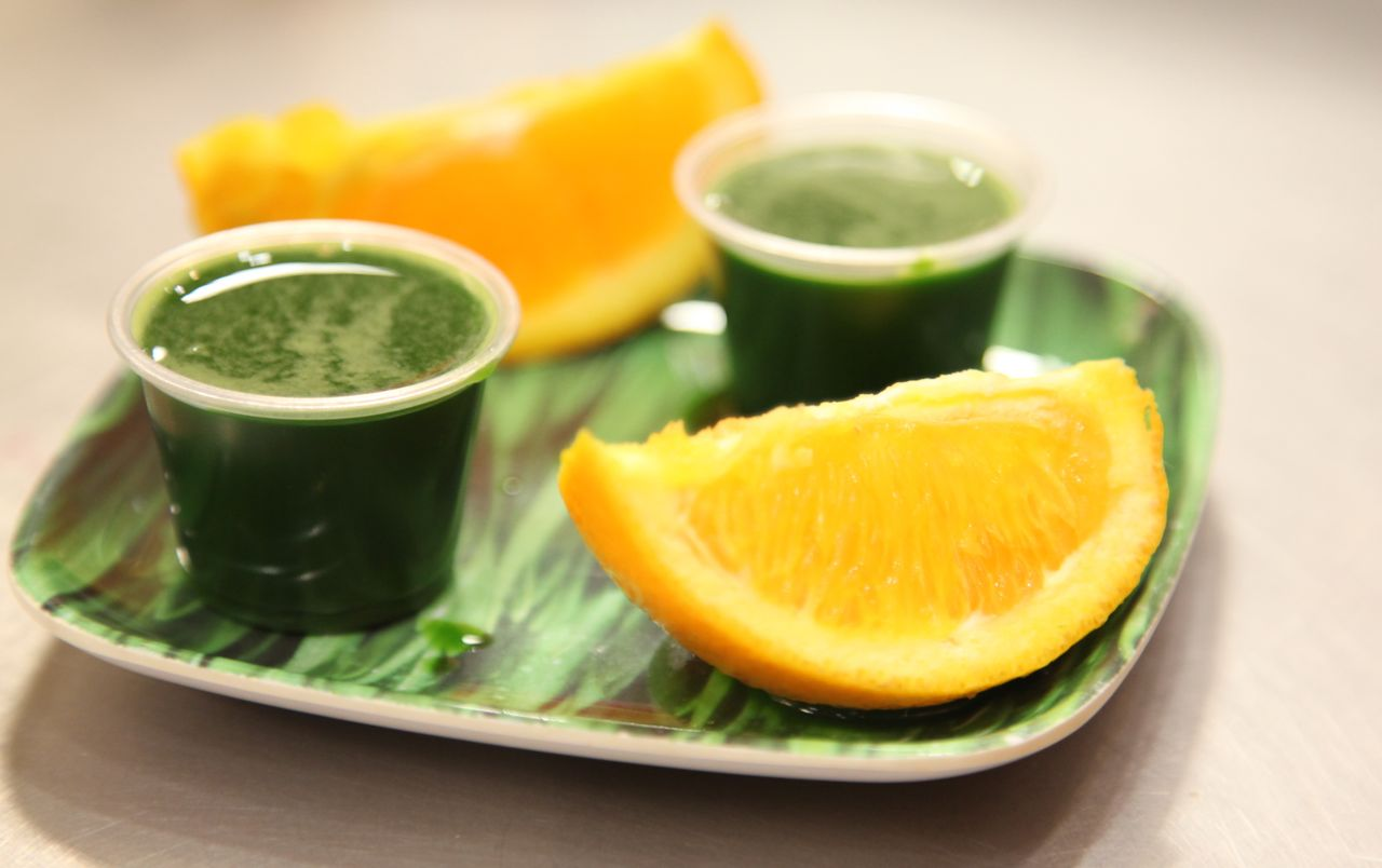 Wheatgrass Juice, sometimes chased with orange slices